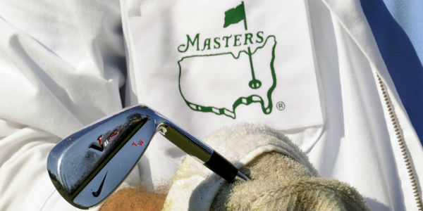 The Masters 2012 - a caddie cleaning a golf club