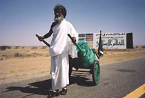 Pilgrim with a handcart to carry his belongings