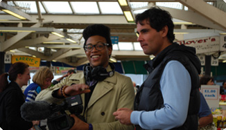Trainees Omari and Ross filming in Leicester market