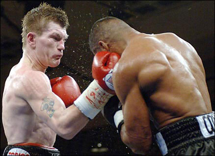 Ricky Hatton (left) lands on uppercut on Juan Urango during their IBF and IBO light-welterweight fight in January