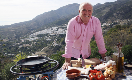 Rick Stein cooking outside.