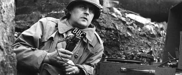 BBC War Correspondent Robin Duff reporting from the front line with a BBC special issue 'midget' recorder