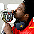 Ras Kwame kisses the 1Xtra Cup