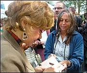 Prunella signing autographs