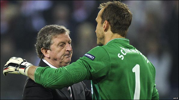 Hodgson embraces goalkeeper Mark Schwarzer after the game