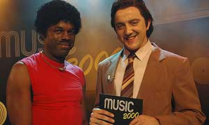 Music contestant Antony Carmichael (Chris Obi) with Look Around You presenter Peter Packard (Peter Serafinowicz)