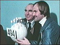 Mick Mills is given a cake to mark his 494th match