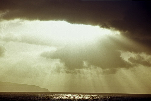 Sunlight through the clouds from Portstewart looking out to Donegal
