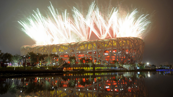 Fireworks exploding outside Beijing's National 'Bird Nest' Stadium during the opening ceremony for the 2008 Olympics.