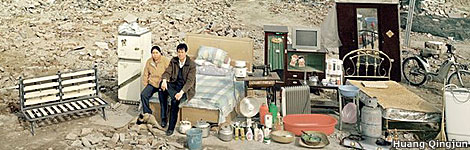 Huang Qingju's photo of a family outside their house