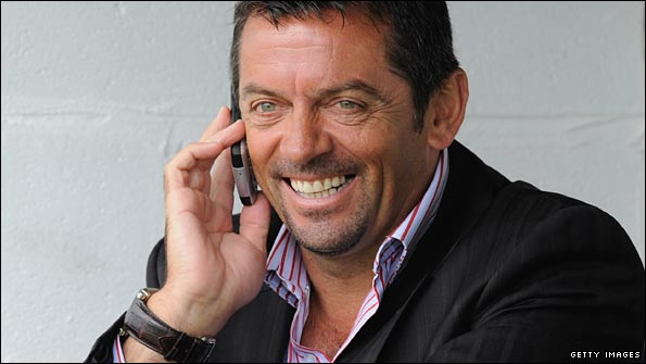Phil Brown chats on his phone