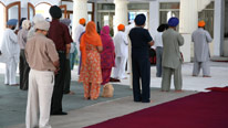 Sikhs praying in gurdwara. Source: iStockphoto © Loic Bernard