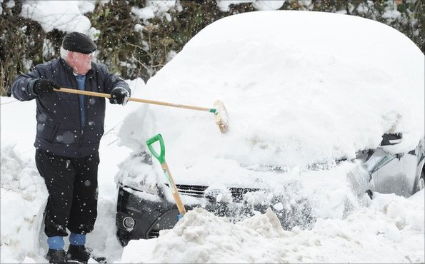 A car being dug out of snow