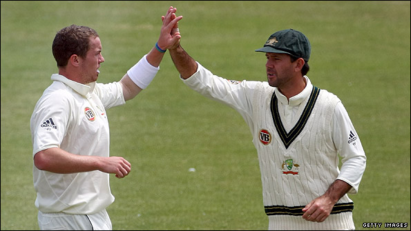 Peter Siddle and Ricky Ponting celebrate a Sussex wicket