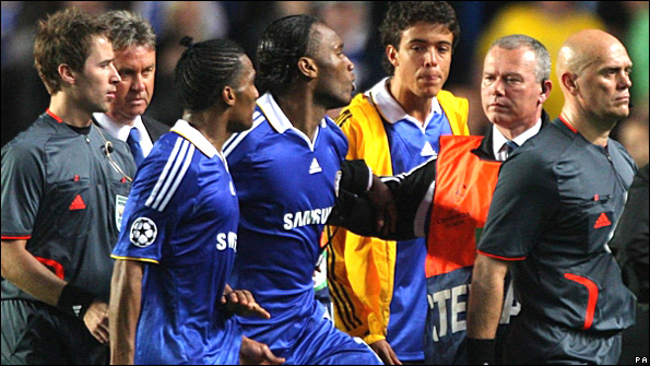 Didier Drogba argues with the referee