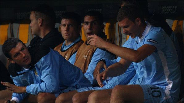 Carlos Tevez (centre) and the Manchester City substitutes at the Allianz Arena