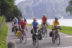 Touring cyclists by lake
