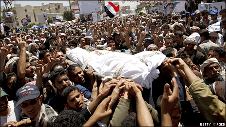 Yemeni anti-government protesters carry the body of a comrade who was among 52 people killed by security forces in a violent crackdown last week