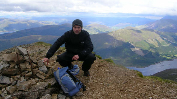 Man at the top of the Sgurr Dearg