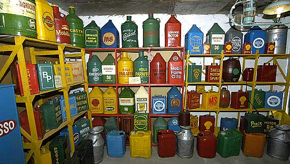 Oil & Fuel cans, lovingly restored, right down to the brass caps.