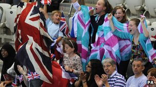 Young fans cheer on the swimmers