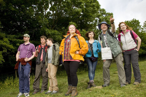 The cast of The Great Outdoors in a field, decked in rambling clothes