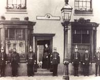 Photograph showing some of the Birmingham police force outside their station