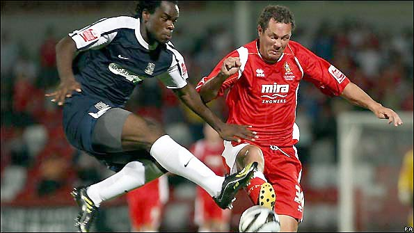 Julian Alsop (right) tangles with Southend United's Jean-Yves Mvoto