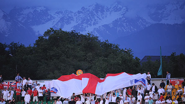 England fans in the ground in front of a beautiful mountain backdrop
