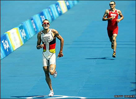 Germany's Jan Frodeno (left) outsprints Canada's Simon Whitfield to win triathlon gold