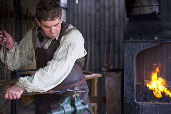Simon the Ironmonger at work in the Victorian forge