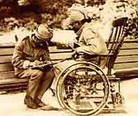 Photo of a wounded Indian soldier dictating a letter