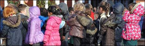 Children wait in a line at a primary school in England