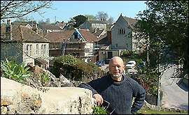 Michael Eavis in front of the working mens club and village hall
