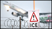 An ice warning sign at Heathrow airport as a plane takes off behind