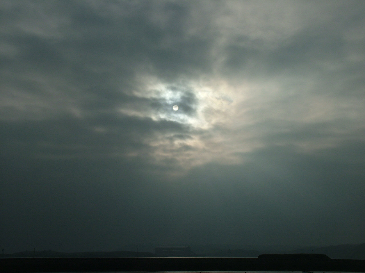 1 Feb: sun breaking through thin medium level clouds (13.37)