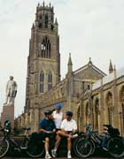 Cyclists in front of St Botolph's Church, Boston, England
