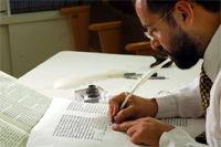 A Torah being copied