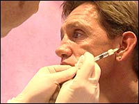Mike Wood receiving an injection