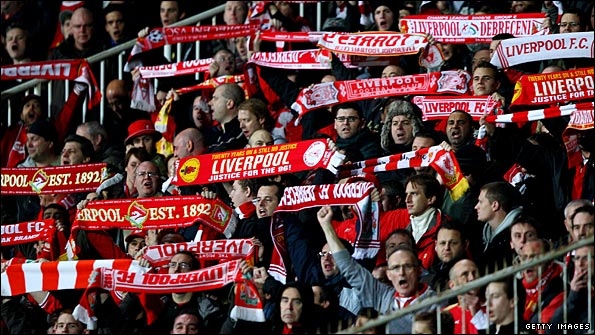 Liverpool fans sing their support during the game in Hungary
