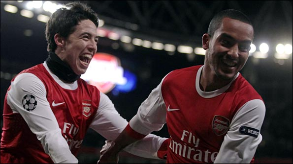 Nasri and Walcott celebrate another goal against Partizan