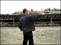 A still from a video from YouTube of Matti Juhnai Saari firing a gun