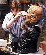 Re-touching Davros' make-up during filming