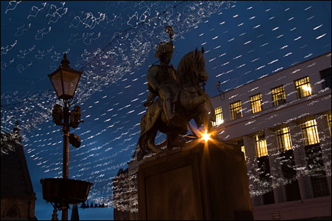 Statue against lights. By Giuseppe Bignardi