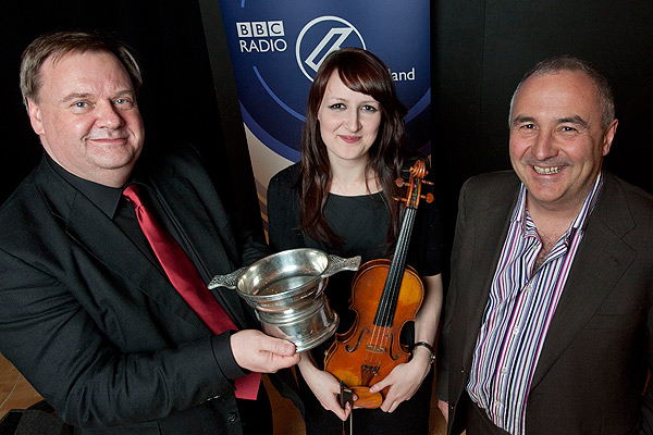 The BBC Radio Scotland Young Traditional Musician of the Year 2011 Award winner Kristan Harvey with Jeff Zycinski and Andrew Dixon, Chief Executive of Creative Scotland.