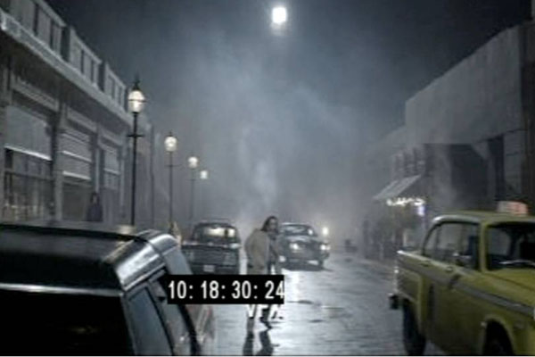 A screenshot of Nick Frost crossing the road on the set of Money before the special effects and CGI were added to the background