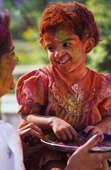 A young girl covered in paint