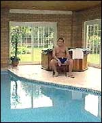 Adrian relaxing by his swimming pool