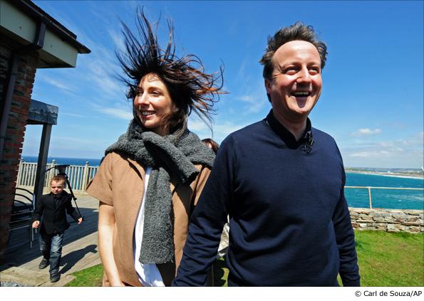 Conservative Party leader David Cameron, right, and his wife Samantha walk in Newquay, Cornwall