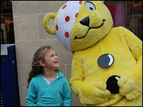 Pudsey Bear and child